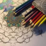 pencils laying beside a half-drawn mandala